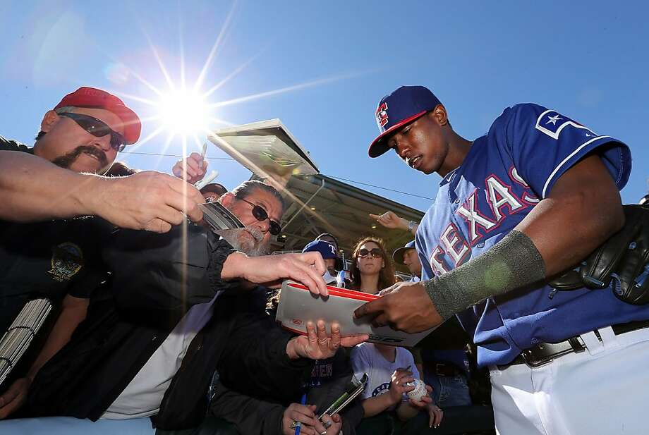 SURPRISE, AZ - FEBRUARY 22:  Jurickson Profar #13 of the Texas Rangers signs autographs for fans before the spring training game at Surprise Stadium on February 22, 2013 in Surprise, Arizona.  (Photo by Christian Petersen/Getty Images) Photo: Christian Petersen, Getty Images