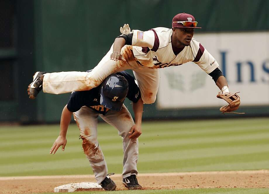 Southern's Brian Ortiz, below, is out at second base as Texas Southern's second baseman De'Mario Thibodeaux completes the double play at the MLB Urban Invitational tournament Friday, Feb. 22, 2013, in Houston. (AP Photo/Pat Sullivan) Photo: Pat Sullivan, Associated Press