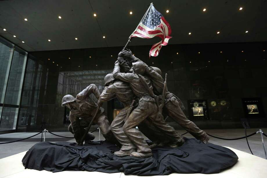 The original 12½-foot cast stone version of Felix de Weldon's iconic statue depicting Marines and a Navy corpsman raising the U.S. flag at Iwo Jima failed to reach the minimum price during Friday's auction. Photo: Mary Altaffer, STF / AP