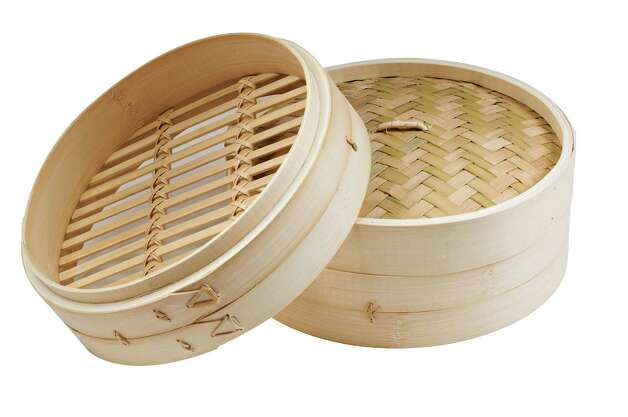 This bamboo steamer, used in Asian cooking, is by IMUSA and available at Target and Target.com. Photo: Contributed Photo / Connecticut Post Contributed