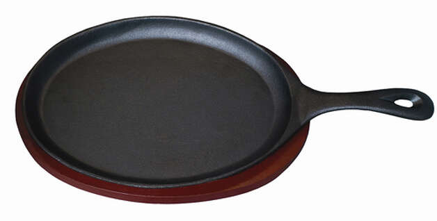 This IMUSA cast iron skillet with wood base is for searing meats and vegetables for Mexican fajitas. It's available at Target and Target.com. Photo: Contributed Photo