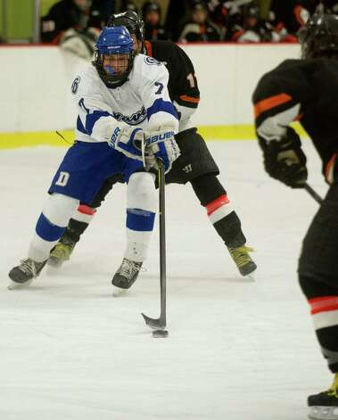 Darien's Jack Knowlton controls the puck during Friday's FCIAC quarterfinal game against Stamford at Terry Connors Rink on February 22, 2013. Photo: Lindsay Perry / Stamford Advocate
