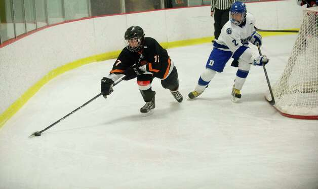 Stamford's Andrew Kydes controls the puck during Friday's FCIAC quarterfinal game against Darien at Terry Connors Rink on February 22, 2013. Photo: Lindsay Perry / Stamford Advocate
