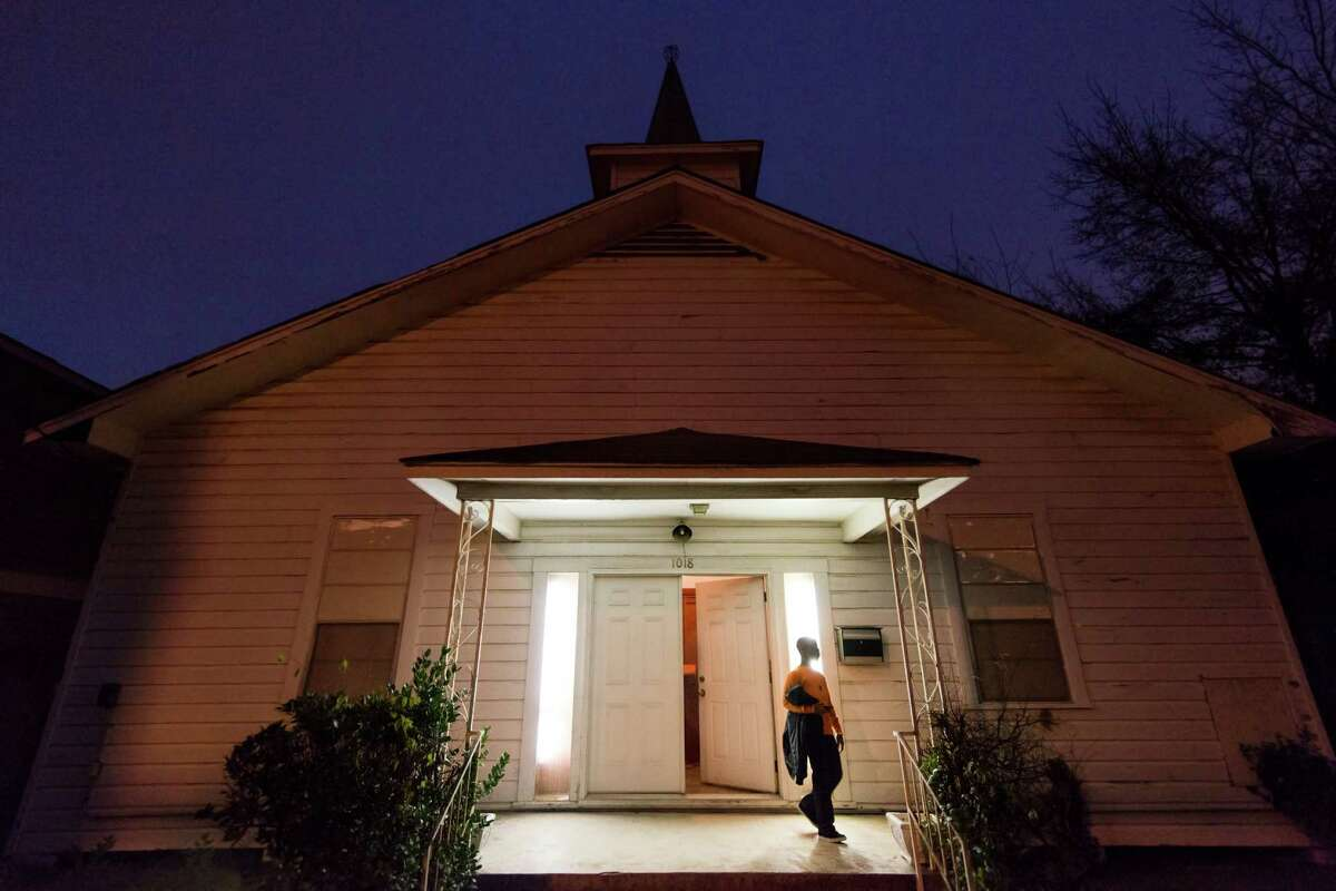 Terrance Williams departs choir rehearsal as evening falls on Mt. Calvary Missionary Baptist Church on Saturday, Feb. 9, 2013, in Houston. The church has been a fixture on Herkimer Street in Houston's Heights for nearly a century. In the last few years, the aging neighborhood of legacy homes have been sold and razed to make way for multistory new homes and their residents. Nowadays, the singing, preaching and shouting at Mt. Calvary has prompted police calls for noise complaints as friction between neighbors, old and new, creeps into the dynamic of a transforming neighborhood.