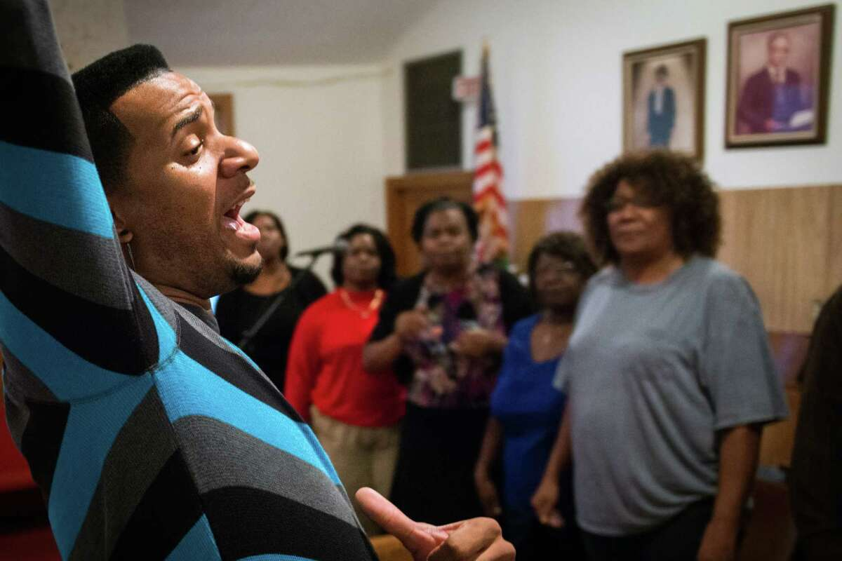 Jay Elmore directs choir rehearsal at Mt. Calvary Missionary Baptist Church on Saturday, Feb. 9, 2013, in Houston.
