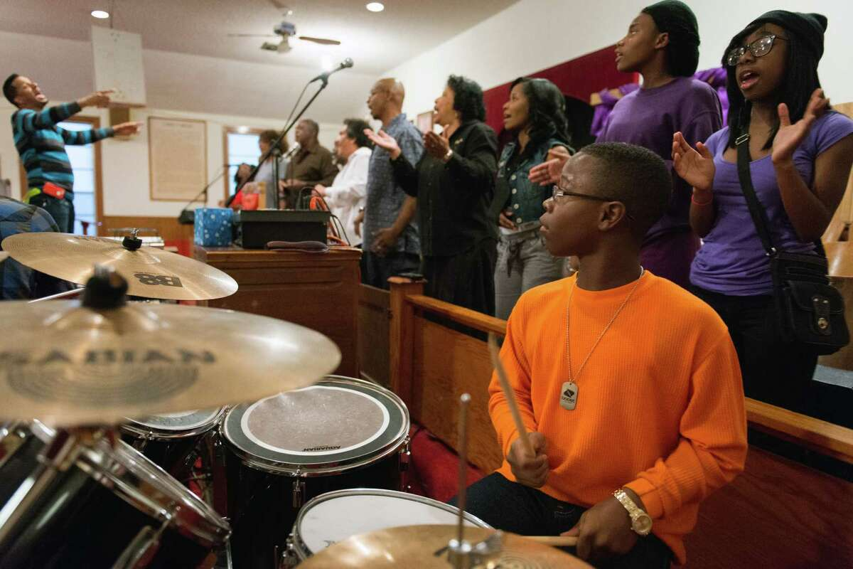 Terrance Williams plays the drums as Jay Elmore directs choir rehearsal at Mt. Calvary Missionary Baptist Church on Saturday, Feb. 9, 2013, in Houston.