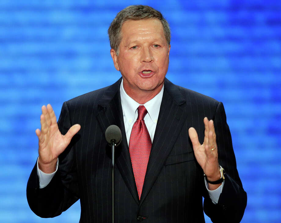 FILE - In this Tuesday, Aug. 28, 2012 file photo, Ohio Gov. John Kasich addresses the Republican National Convention in Tampa, Fla.  Kasich is expected to reveal his decision on whether to cover more low-income people now left out of the Medicaid program, in his state budget proposal, Monday, Feb. 4, 2013. (AP Photo/J. Scott Applewhite, File) Photo: J. Scott Applewhite, STF / AP