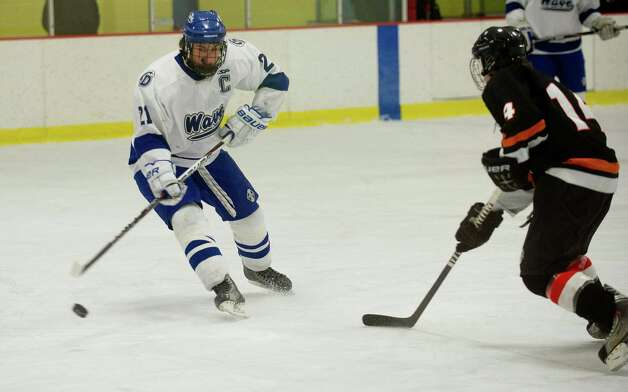 Darien's Brendan Hathaway controls the puck during Friday's FCIAC quarterfinal game against Stamford at Terry Connors Rink on February 22, 2013. Photo: Lindsay Perry / Stamford Advocate