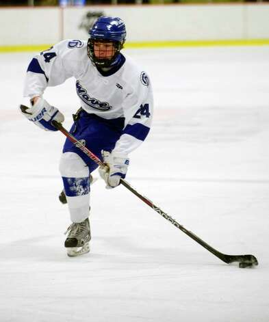 Darien's Dillion Fitzpatrick controls the puck during Friday's FCIAC quarterfinal game against Stamford at Terry Connors Rink on February 22, 2013. Photo: Lindsay Perry / Stamford Advocate