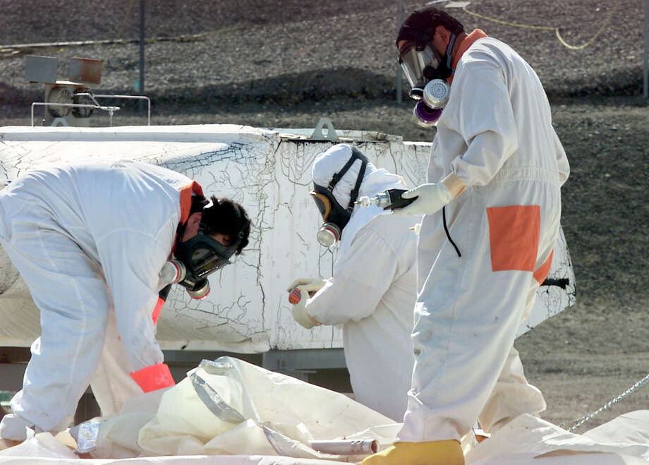 """FILE -- In this March 23, 2004 file photo, workers at the tank farms on the Hanford Nuclear Reservation near Richland, Wash., measure for radiation and the presence of toxic vapors. Six underground radioactive waste tanks at the nation's most contaminated nuclear site are leaking, Gov. Jay Inslee said Friday, Feb. 22, 2013. Inslee made the announcement after meeting with federal officials in Washington, D.C. Last week it was revealed that one of the 177 tanks at south-central Washington's Hanford Nuclear Reservation was leaking liquids. Inslee called the latest news """"disturbing."""" (AP Photo/Jackie Johnston, File) Photo: JACKIE JOHNSTON, STR / AP"""
