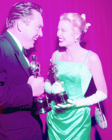 Grace Kelly and screenwriter George Seaton in 1955. They both received Oscars for the 1954 film The Country Girl. Kelly's silk gown, designed by Edith Head, was the most expensive in Oscar history at the time, according to People.com. Photo: Silver Screen Collection, Getty Images / 2007 Getty Images