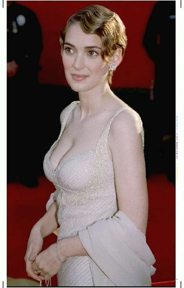 Winona Ryder channeled a 1920s flapper in this clingy beaded Armani gown and finger-waved hair in 1995.
