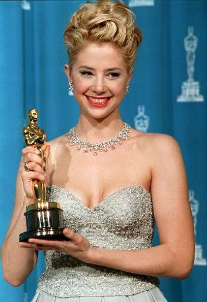 Mira Sorvino, best actress winner for Mighty Aphrodite, in Armani and an elegant updo in 1996.