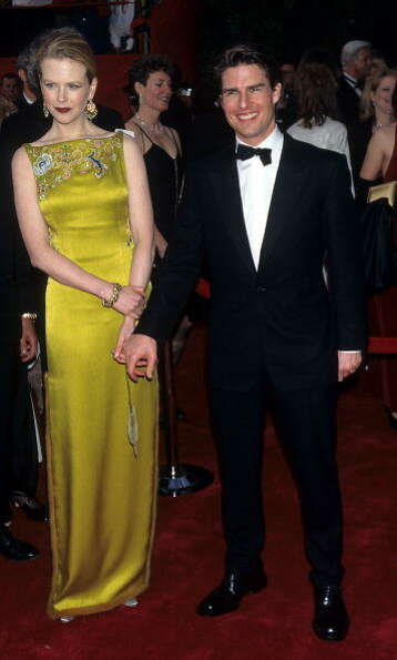 Nicole Kidman with then-husband Tom Cruise in what would be the first of many phenomenal Oscar looks