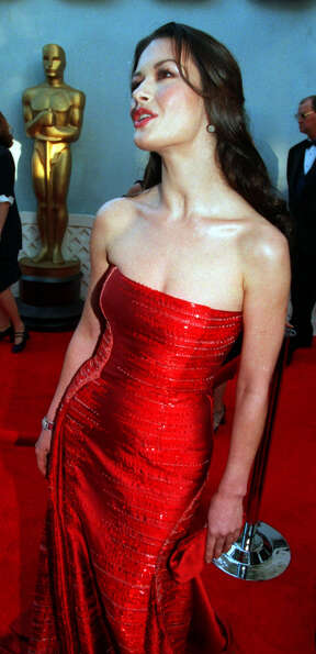 Catherine Zeta-Jones in what many consider the iconic red carpet dress, by Versace, in 1999.