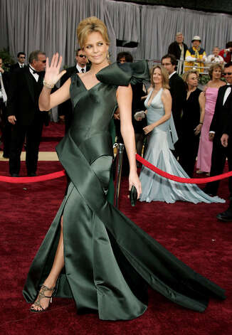 Charlize Theron had a major bow moment in 2006 with this Galliano gown made from a leathery silk satin. Photo: Frazer Harrison, Getty Images / 2006 Getty Images
