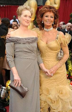 Meryl Streep has favored deep-V wrap dresses in recent years, but we prefer this low-key Alberta Ferretti look she wore in 2009.