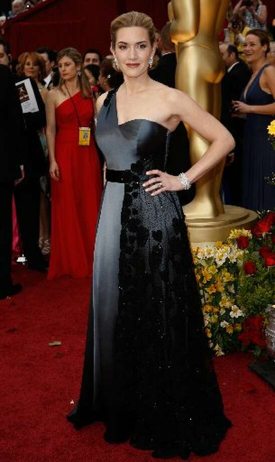 Kate Winslet, who won Best Actress for The Reader in 2009, wore a gunmetal Yves Saint Lauren Atelier dress.