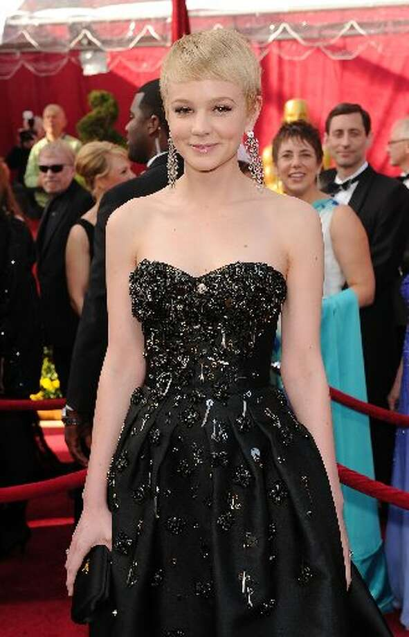 Carey Mulligan in Prada in 2010, with a raised hem in front.