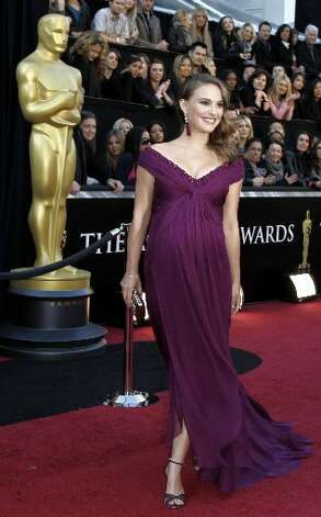 Natalie Portman, best actress winner for Black Swan, looked radiant in 2011 in a deep plum gown by Rodarte.