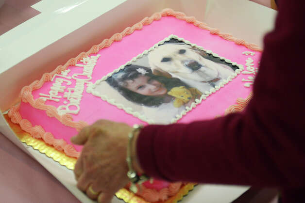 The event was held on what would have been Charlotte Bacon's seventh birthday, so attendees brought a birthday cake in remembrance of her life. Photo: Tyler Sizemore / The News-Times