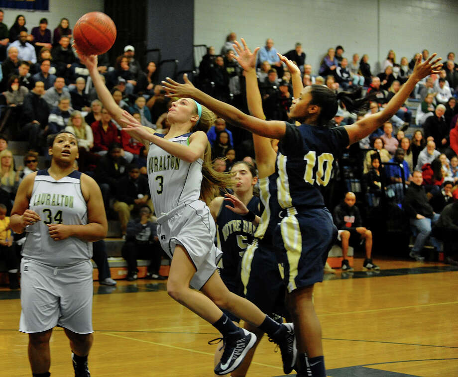 Lauralton Hall's #3 Maggie Salandra lays up the ball between Notre Dame of Fairfield defenders #10 Jerlisa Thomas and #52 Nakia Mabin, behind her, during SWC girls basketball tournament action in Stratford, Conn. on Friday February 22, 2013. Photo: Christian Abraham / Connecticut Post
