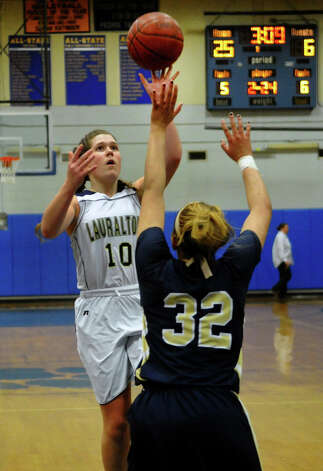 Lauralton Hall's #10 Carly Fabbri sends a shot over Notre Dame of Fairfield defender #32 Brianna Mann, during SWC girls basketball tournament action in Stratford, Conn. on Friday February 22, 2013. Photo: Christian Abraham / Connecticut Post