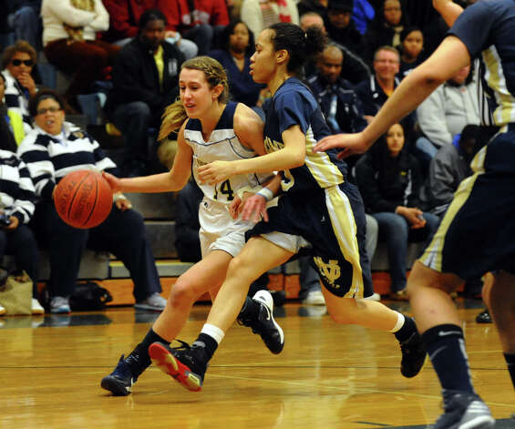 Lauralton Hall's #14 Michelle DeSantis drives past Notre Dame of Fairfield defender #3 Amber James, during SWC girls basketball tournament action in Stratford, Conn. on Friday February 22, 2013. Photo: Christian Abraham / Connecticut Post