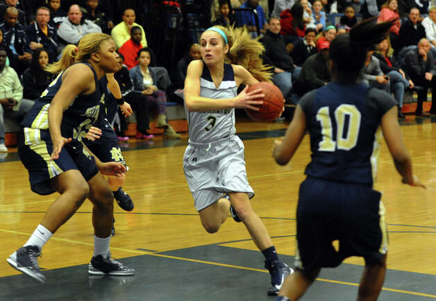 Lauralton Hall's #3 Maggie Salandra drives the ball between Notre Dame of Fairfield defenders #10 Jerlisa Thomas and #52 Nakia Mabin, at left, during SWC girls basketball tournament action in Stratford, Conn. on Friday February 22, 2013. Photo: Christian Abraham / Connecticut Post