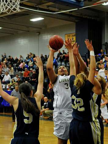 Lauralton Hall's #34 Olivia Levey attempts a shot over Notre Dame of Fairfield defenders, during SWC girls basketball tournament action in Stratford, Conn. on Friday February 22, 2013. Photo: Christian Abraham / Connecticut Post