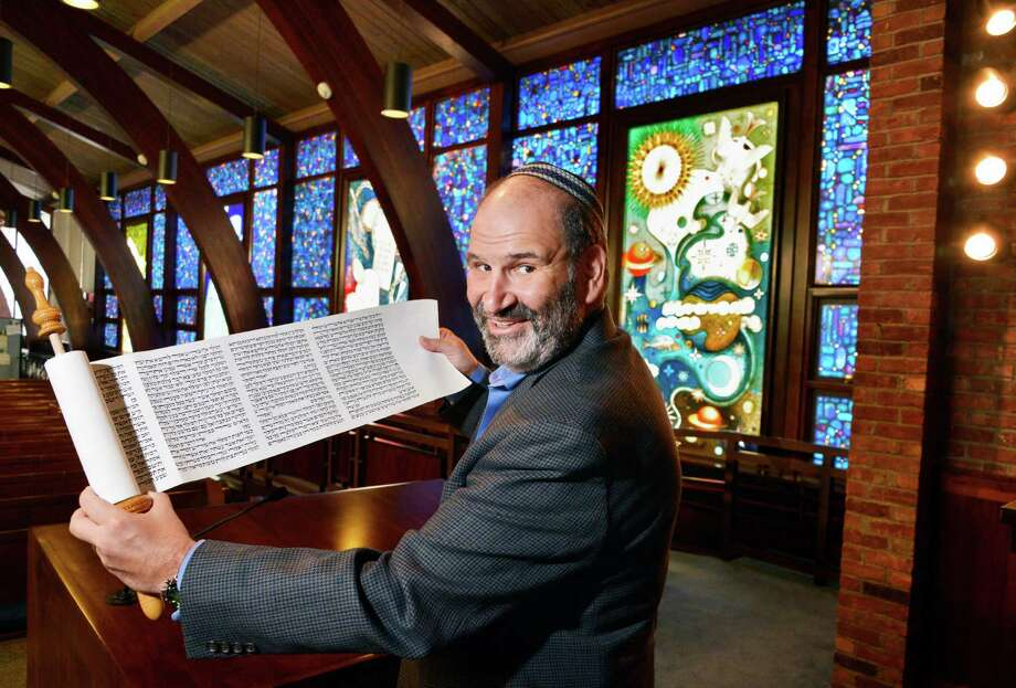 Rabbi Matthew Cutler holds a Megillat Esther or Scroll of Esther, at  Congregation Gates of Heaven in Schenectady Wednesday Feb. 20, 2013.  (John Carl D'Annibale / Times Union) Photo: John Carl D'Annibale / 00021233A
