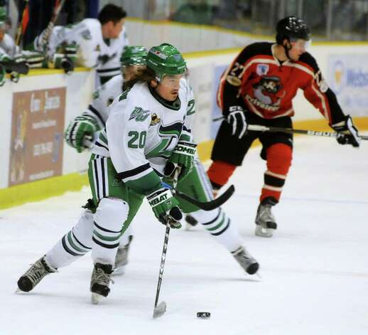 Danbury Whalers, Chris Atkinson, has possession during a game against the Thousand Island Privateers in Danbury on Friday, Feb. 22, 2013. Photo: Lisa Weir / The News-Times Freelance