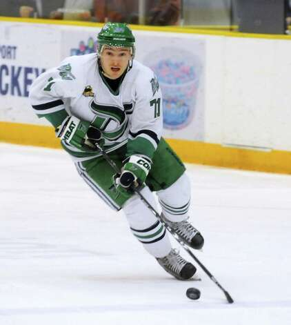 Danbury Whalers, Kimil Vavra, has possession over the Thousand Islands privateers during a game in Danbury on Friday, Feb. 22, 2013. Photo: Lisa Weir / The News-Times Freelance