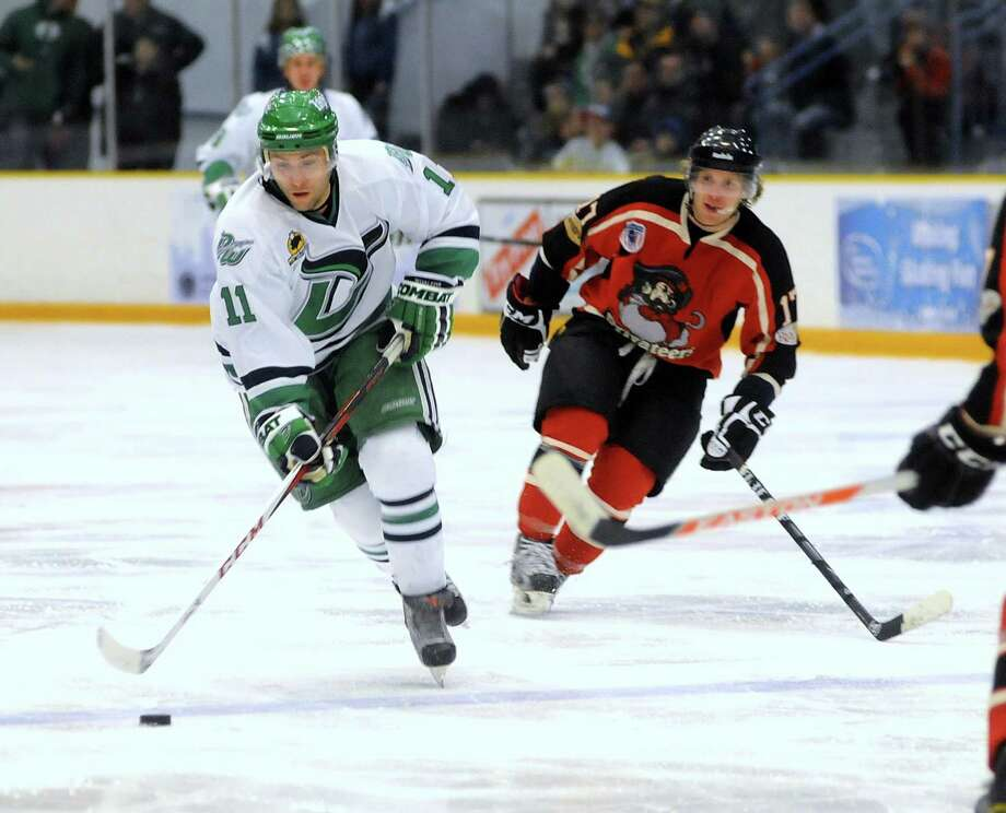 Danbury Whalers, Phil Aucoin, skates against Max Mobley during a game against the Thousand Island Privateers in Danbury on Friday, Feb. 22, 2013. Photo: Lisa Weir / The News-Times Freelance