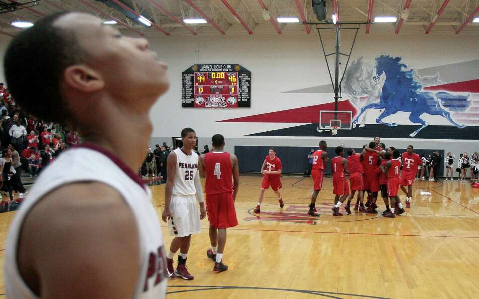 2/22/13: Brandon Sneed (40) of Pearland Oilers walks off the court as the Fort bend Tigers celebrate