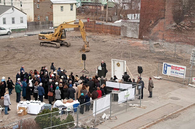 Public officials and supporters gather Thursday morning for groundbreaking ceremonies for a new $5.5 million building that will house services of Unity House in Troy's North Central neighborhood.