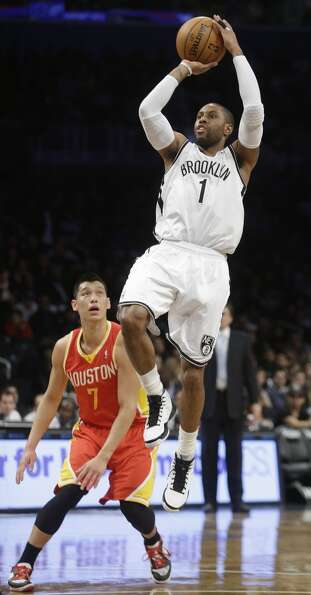 Feb. 22: Rockets 106, Nets 96Nets guard C.J. Watson drives past Rockets