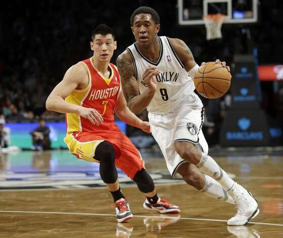 MarShon Brooks of the Nets drives past Rockets guard Jeremy Lin.