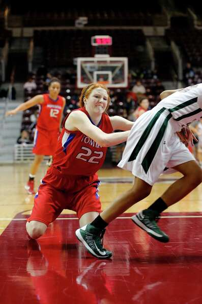 Tomball forward, Hannah Plucheck, 22, fights for control of the ball during the second half of a reg
