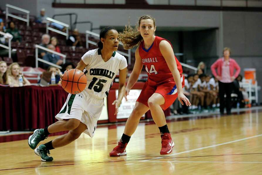 Connally guard Bria Freeland, 15, drives past Tomball guard Mandy Moerschell, 14, during the first h