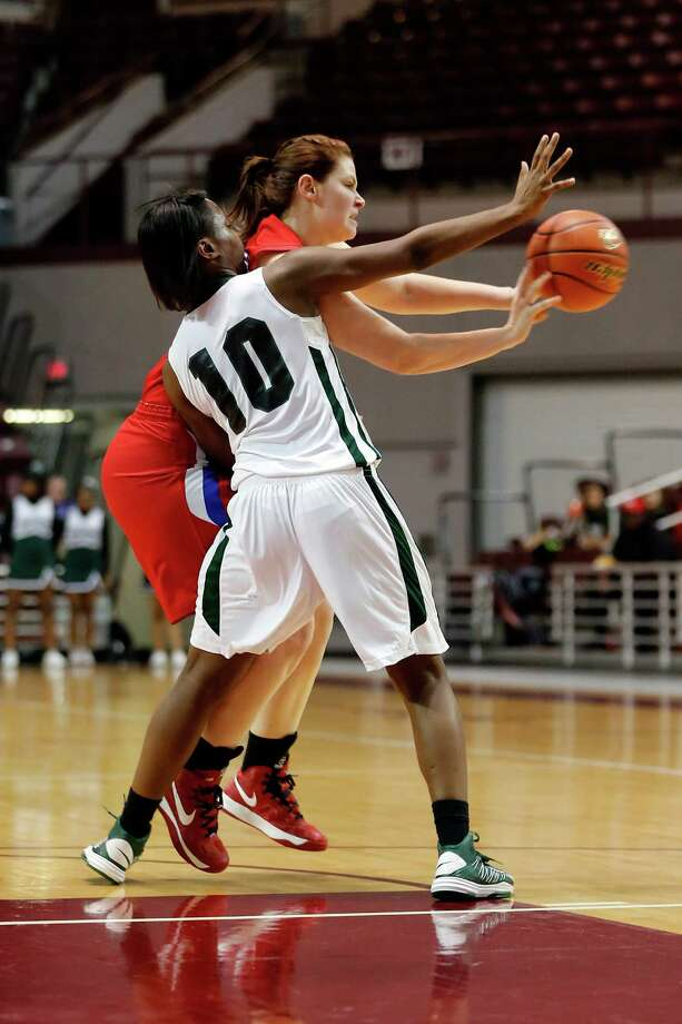 Connally guard, Shoniquia Coleman, 10, fights for control of the ball during the second half of a region 3 4A girls high school basketball game between the Connally High School Lady Cougars and the Tomball High School Lady Cougars, Friday, February 22, 2013 at the Campbell Center in Houston, Texas. Tomball defeated Connally to advance in the playoffs. Photo: TODD SPOTH, For The Chronicle / Todd Spoth