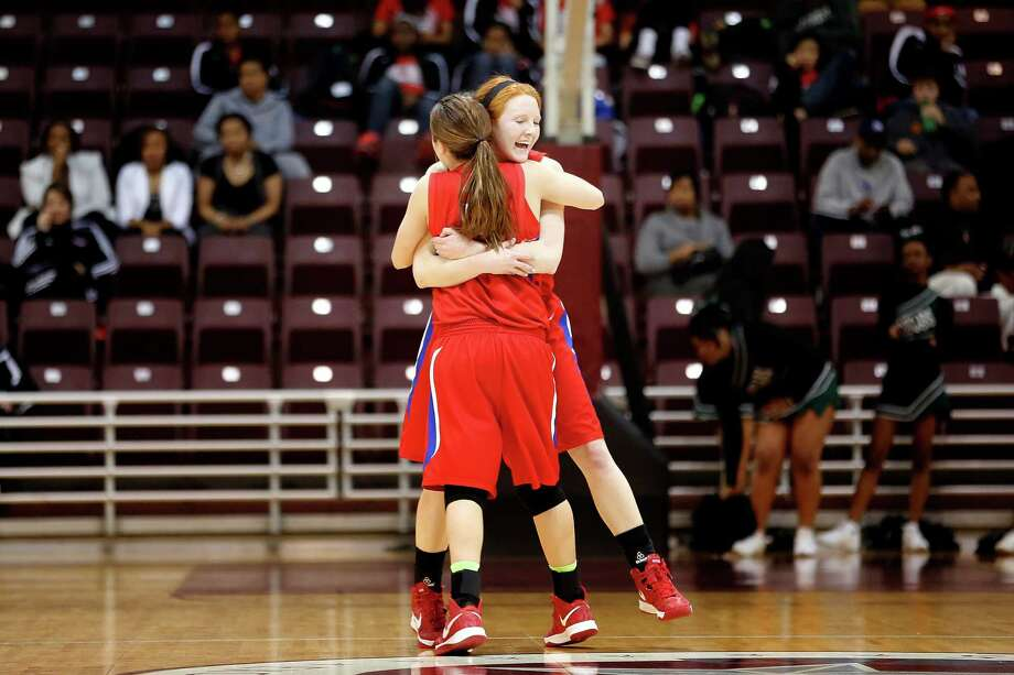 Tomball guard, Lexe Marks, and forward, Hannah Plucheck, hug following a win during a region 3 4A girls high school basketball game between the Connally High School Lady Cougars and the Tomball High School Lady Cougars, Friday, February 22, 2013 at the Campbell Center in Houston, Texas. Tomball defeated Connally to advance in the playoffs. Photo: TODD SPOTH, For The Chronicle / Todd Spoth