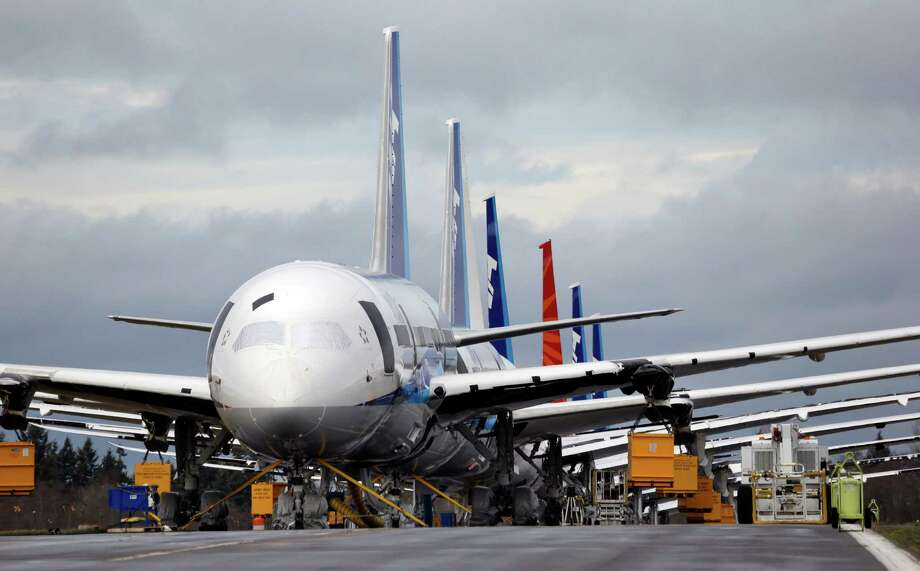 Boeing 787 jets are parked in Everett, Wash. Boeing is proposing a fix for the plane's batteries that could allow the airliners to resume flights as early as April. Photo: Elaine Thompson, STF / AP