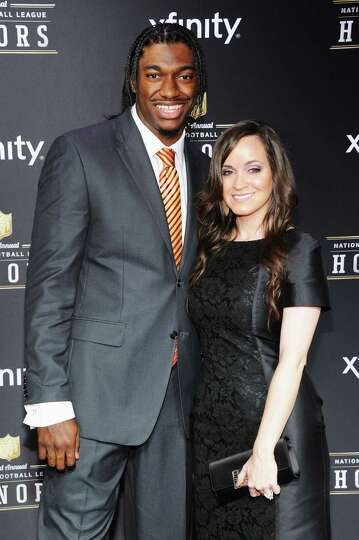 NEW ORLEANS, LA - FEBRUARY 02:  NFL player Robert Griffin III (L) and Rebecca Liddicoat attend the 2
