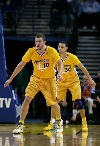 OAKLAND, CA - FEBRUARY 22: David Lee #10 and Stephen Curry #30 of the Golden State Warriors wear their new short sleeved uniforms during their game against the San Antonio Spurs at Oracle Arena on February 22, 2013 in Oakland, California. NOTE TO USER: User expressly acknowledges and agrees that, by downloading and or using this photograph, User is consenting to the terms and conditions of the Getty Images License Agreement.  (Photo by Ezra Shaw/Getty Images) Photo: Ezra Shaw, Getty Images
