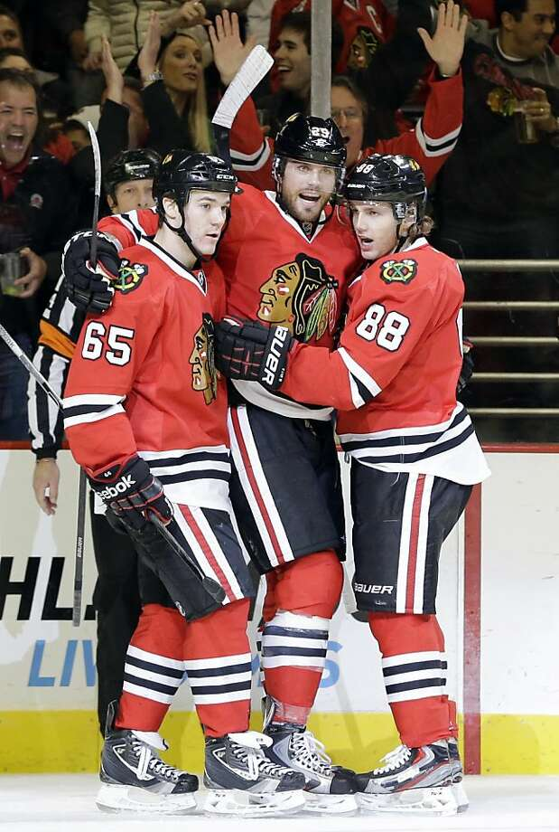Viktor Stalberg (center) receives congratulations after evening the score 1-1. Photo: Nam Y. Huh, Associated Press