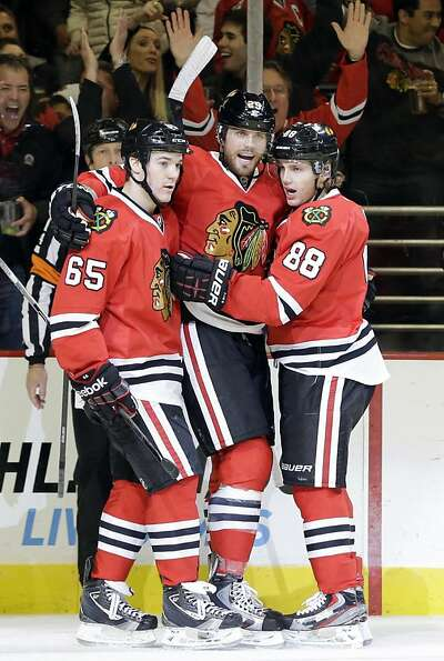 Viktor Stalberg (center) receives congratulations after evening the score 1-1.