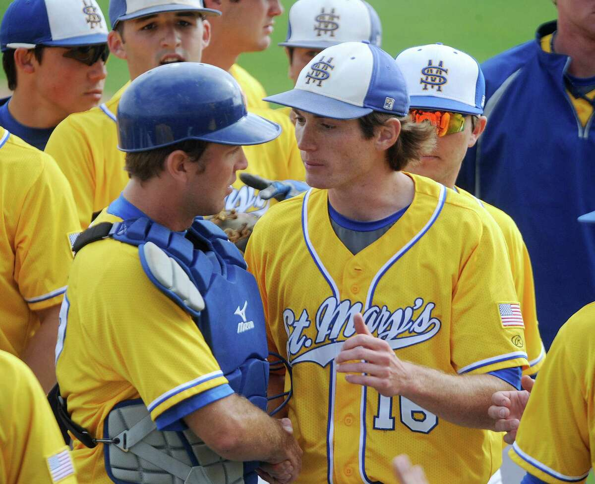St. Mary's Carl O'Neal pitched a one-hitter to beat Oklahoma Panhandle State 1-0. O'Neal won his 21st straight game to tie the Division II mark, according to NCAA records. O'Neal, right, speaks with battery mate Scott Slusher after the game.