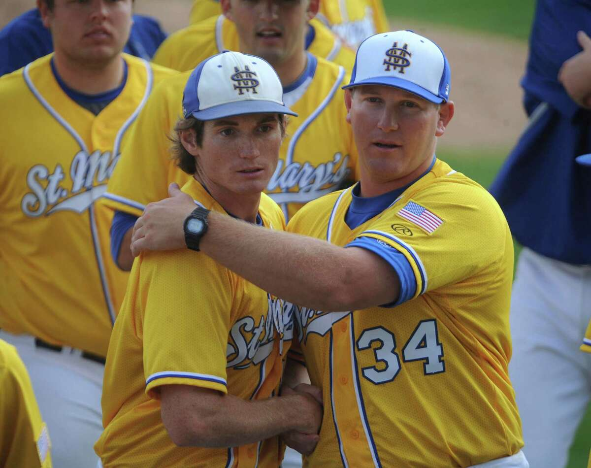 St. Mary's Carl O'Neal pitched a one-hitter to beat Oklahoma Panhandle State 1-0. O'Neal won his 21st straight game to tie the Division II mark, according to NCAA records. O'Neal, left, is congratulated by graduate assistant coach Skye Severns after winning.