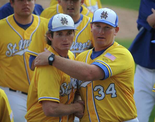 St. Mary's Carl O'Neal pitched a one-hitter to beat Oklahoma Panhandle State 1-0. O'Neal won his 21st straight game to tie the Division II mark, according to NCAA records.  O'Neal, left, is congratulated by graduate assistant coach Skye Severns after winning. Photo: Billy Calzada, Express-News / San Antonio Express-News